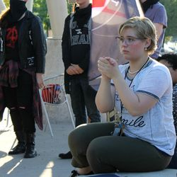 Jenna Martin applauds during a rally in Salt Lake City on Saturday, Sept. 2, 2017. Nearly 100 people gathered in Salt Lake City at a rally protesting police conduct against a University Hospital nurse who refused to allow a blood draw from an unconscious patient.