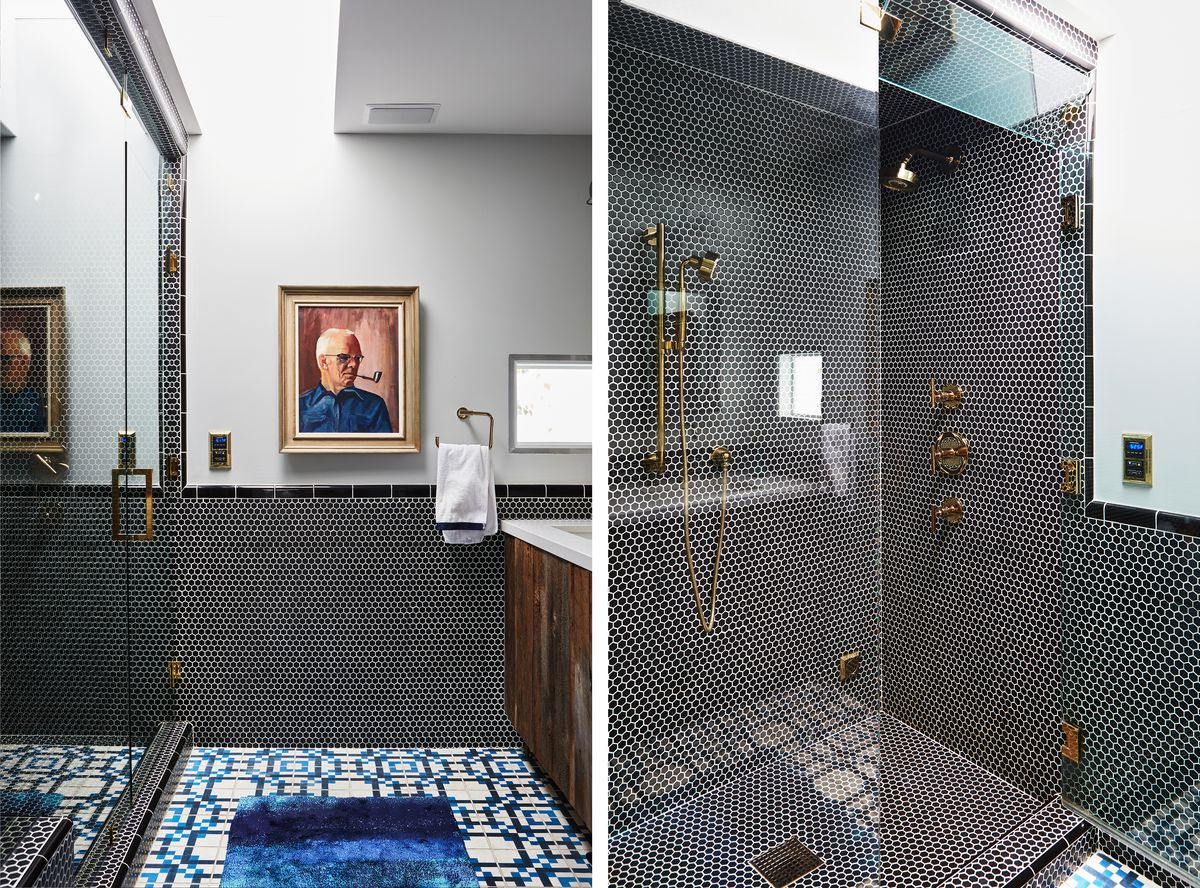 The master bathroom has colorful floor tile, with a portrait of a man smoking a pipe hanging on the wall.