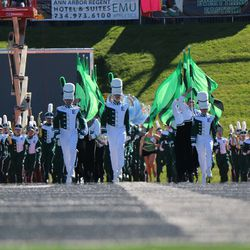 The band marches out on the field