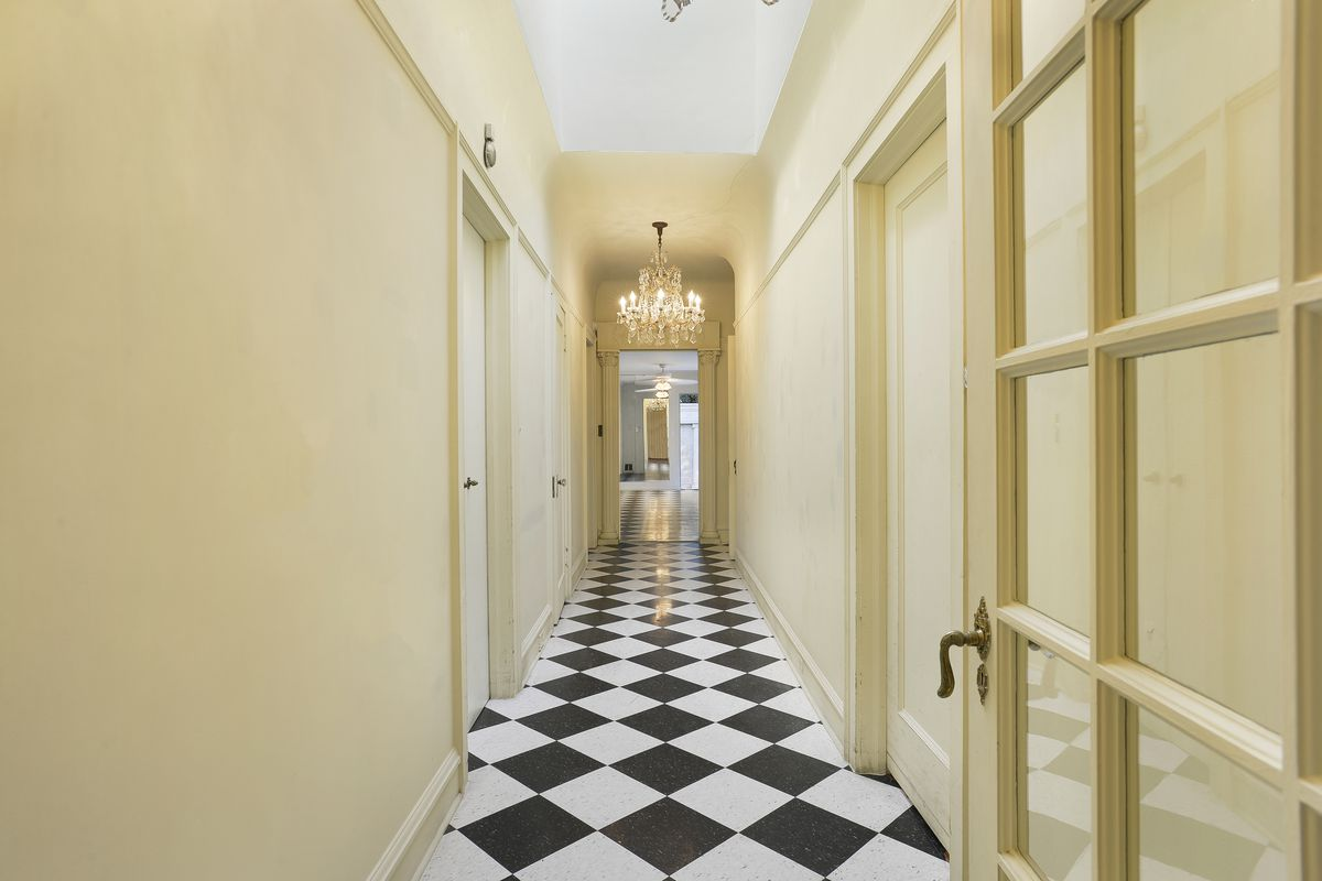 long hallway with checkered floor