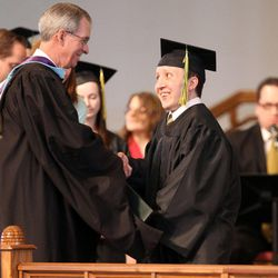LDS Business College President J. Lawrence Richards shakes hands with Cody Wilson Hickmott during LDS Business College's 126th commencement ceremony in the Tabernacle on Temple Square in Salt Lake City on Friday, April 12, 2013.
