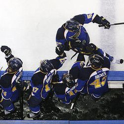 St. Louis Blues left wing David Perron celebrates with teammates after scoring against the San Jose Sharks during the third period in Game 5 of an NHL Stanley Cup first-round hockey playoff series, Saturday, April 21, 2012, in St. Louis. The Blues won 3-1 and won the series 4-1.