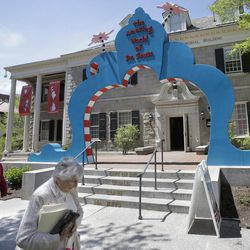In this May 4, 2017, photo people walk near an entrance to The Amazing World of Dr. Seuss Museum, in Springfield, Mass. The new museum devoted to Dr. Seuss, which opened on June 3 in his hometown, features interactive exhibits, a collection of personal belongings and explains how the childhood experiences of the man, whose real name is Theodor Geisel, shaped his work.