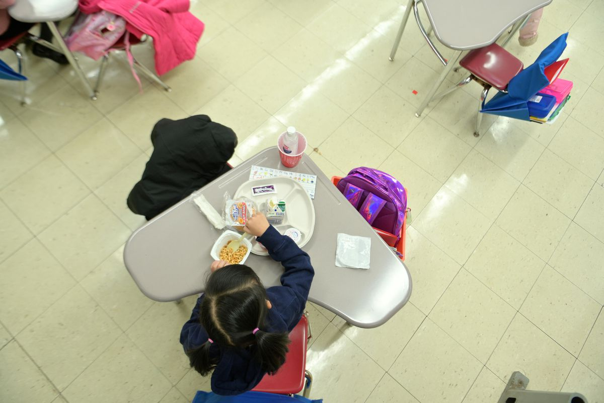 NEW YORK, NEW YORK - JANUARY 13: A kindergarten student eating breakfast at Yung Wing School P.S. 124 on January 13, 2021 in New York City. New York City Public Schools continue to adapt learning environments during the COVID-19 pandemic. The nation's largest school district continues to face uncertainty with COVID-19 cases on the rise city, state and nationwide. (Photo by Michael Loccisano/Getty Images)