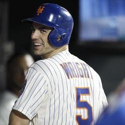 New York Mets David Wright reacts in the dugout after collecting his 1,419th hit to surpass Ed Kranepool for the Mets all-time hits record holder during their baseball game against the Pittsburgh Pirates at Citi Field in New York, Wednesday, Sept. 26, 2012.