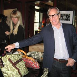 Tommy Hilfiger shows us his wife's purses