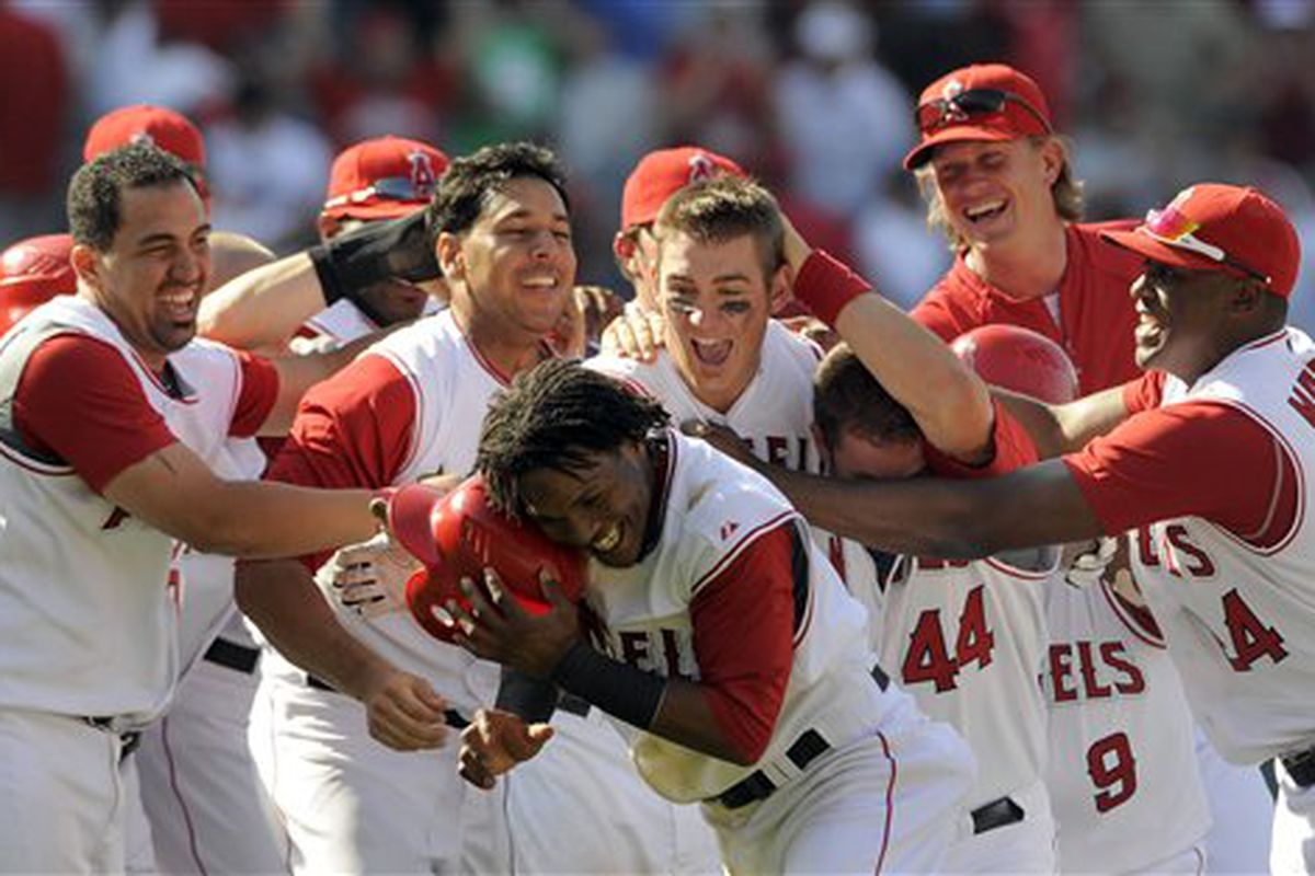 The Los Angeles Angels celebrate their extra inning win over the Boston Red Sox Thursday afternoon.