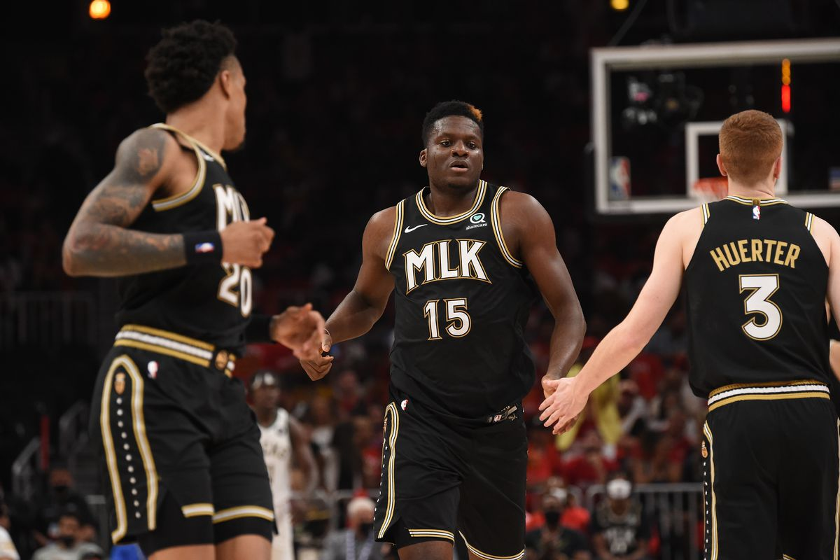Clint Capela of the Atlanta Hawks high-fives teammates during the game against the Milwaukee Bucks during Game 6 of the Eastern Conference Finals of the 2021 NBA Playoffs on July 3, 2021 at State Farm Arena in Atlanta, Georgia.