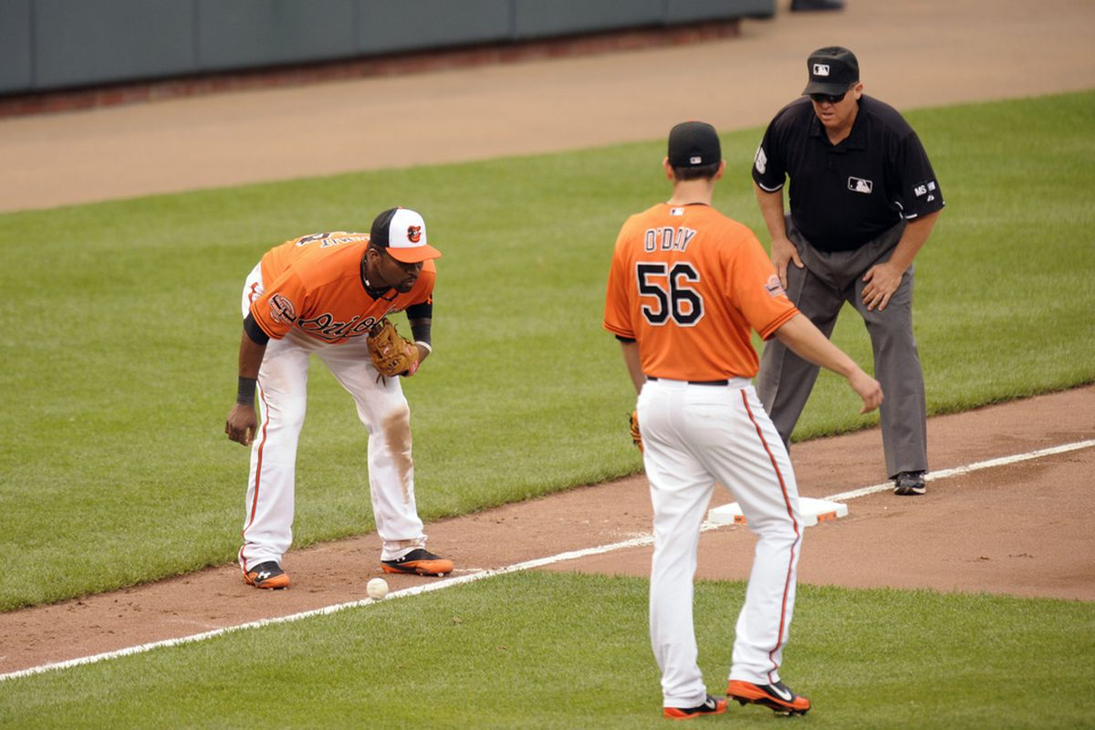 BALTIMORE, MD - MAY 26:  Wilson Betermit #24 and Darren O'Day #56 of the Baltimore Orioles watch Eric Hosmer #35 of the Kansas City Royals bunt stay fair in the seventh inning during a baseball game  at Oriole Park at Camden Yards.
