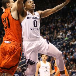Brigham Young Cougars guard Jahshire Hardnett (0) takes a fast-break layup in front of Idaho State Bengals guard Balint Mocsan (20) as BYU takes on Idaho State at the Marriott Center in Provo on Thursday, Dec. 21, 2017.