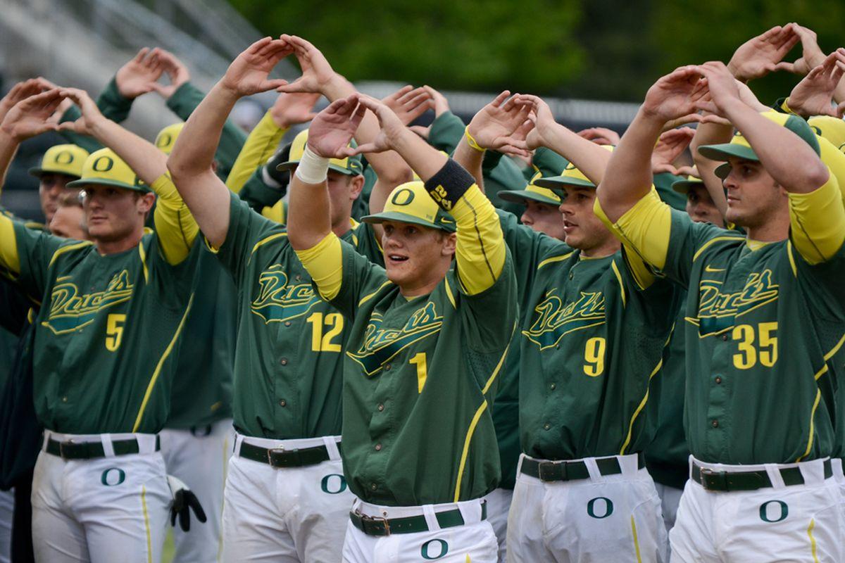 The Oregon Baseball Team, performing some form of ritual dance.