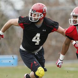 Utah Utes defensive back Brian Blechen (4) works out during spring practice in Salt Lake City Tuesday, March 18, 2014.