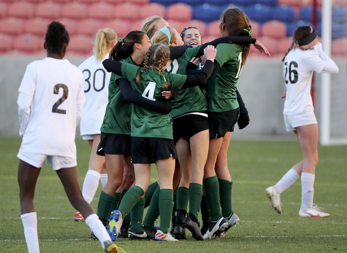 Rowland Hall players celebrate winning the 2A girls soccer state championship game against Real Salt Lake Academy at Rio Tinto Stadium in Sandy on Monday, Oct. 26, 2020. Rowland Hall won 3-2.