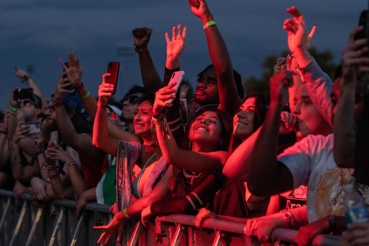 Festival goers head bang Saturday as Bear Grillz performs at the Spring Awakening Musical Festival: Autumn Equinox.