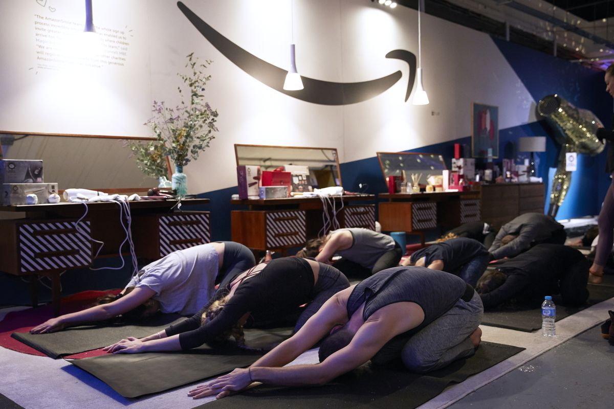 bbf1a46f14d3 An Amazon pop-up shop in London offered yoga on Black Friday. Alex  McBride Getty Images ...