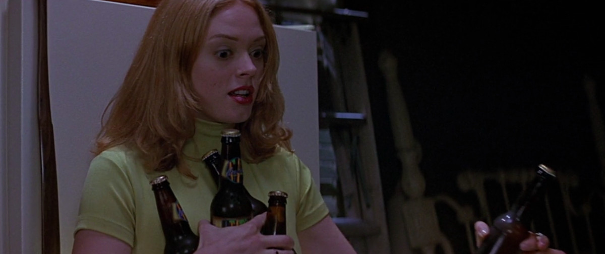 tatum (rose mcgowan) is scared while grabbing beers out of the garage fridge