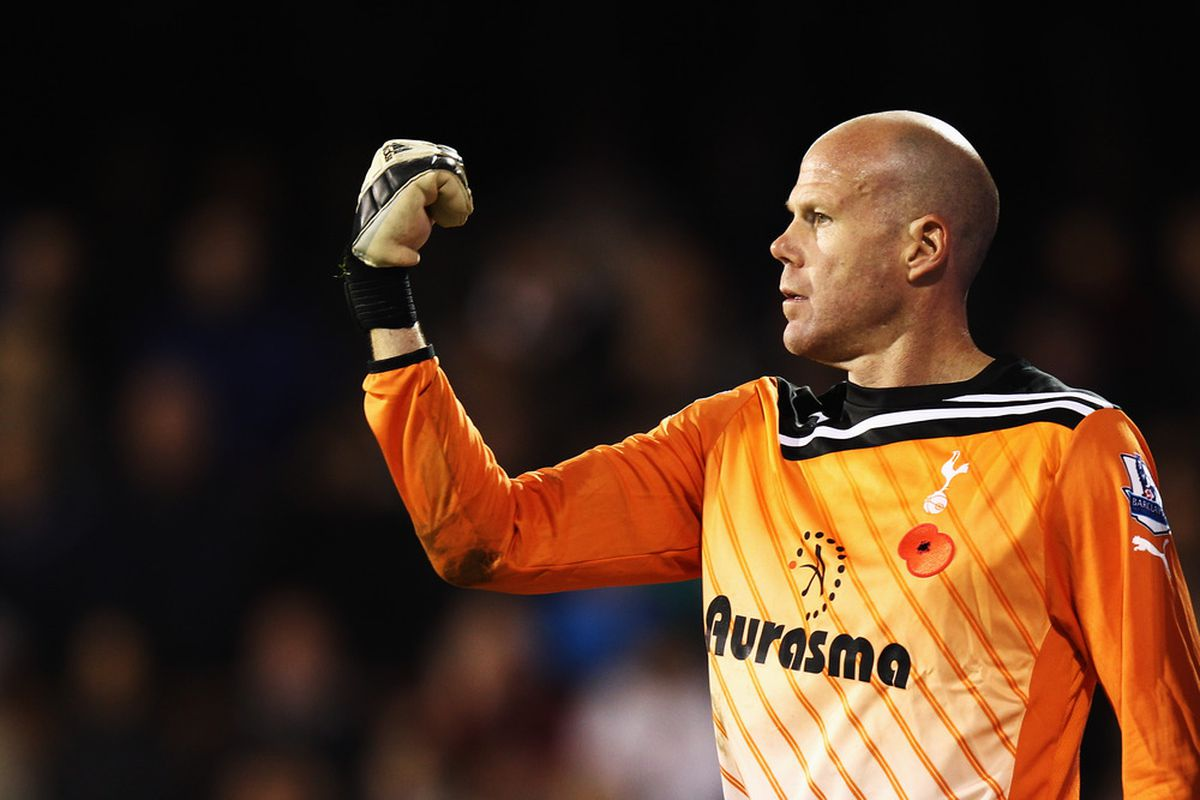 Brad Friedel the Tottenham Hotspur goalkeeper organises his defence during the Barclays Premier League match between Fulham and Tottenham Hotspur at Craven Cottage in London, England.  (Photo by Bryn Lennon/Getty Images)