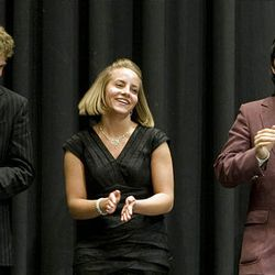 Thomas Christiansen, left, Sterling Scholar for Social Science, Deborah Suzanne Ferry, Sterling Scholar for Music, and Michael Lee, Sterling Scholar for Visual Arts, celebrate at Wednesday's ceremony.