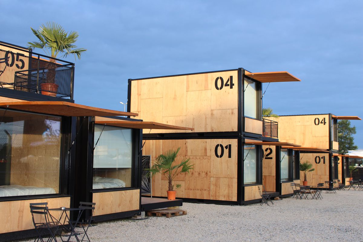 Shipping container hotel with wooden cladding