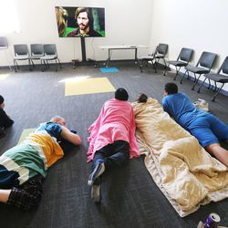 Homeless youth watch a movie at Volunteers of America's Youth Resource Center in Salt Lake City on Thursday, Sept. 15, 2016.