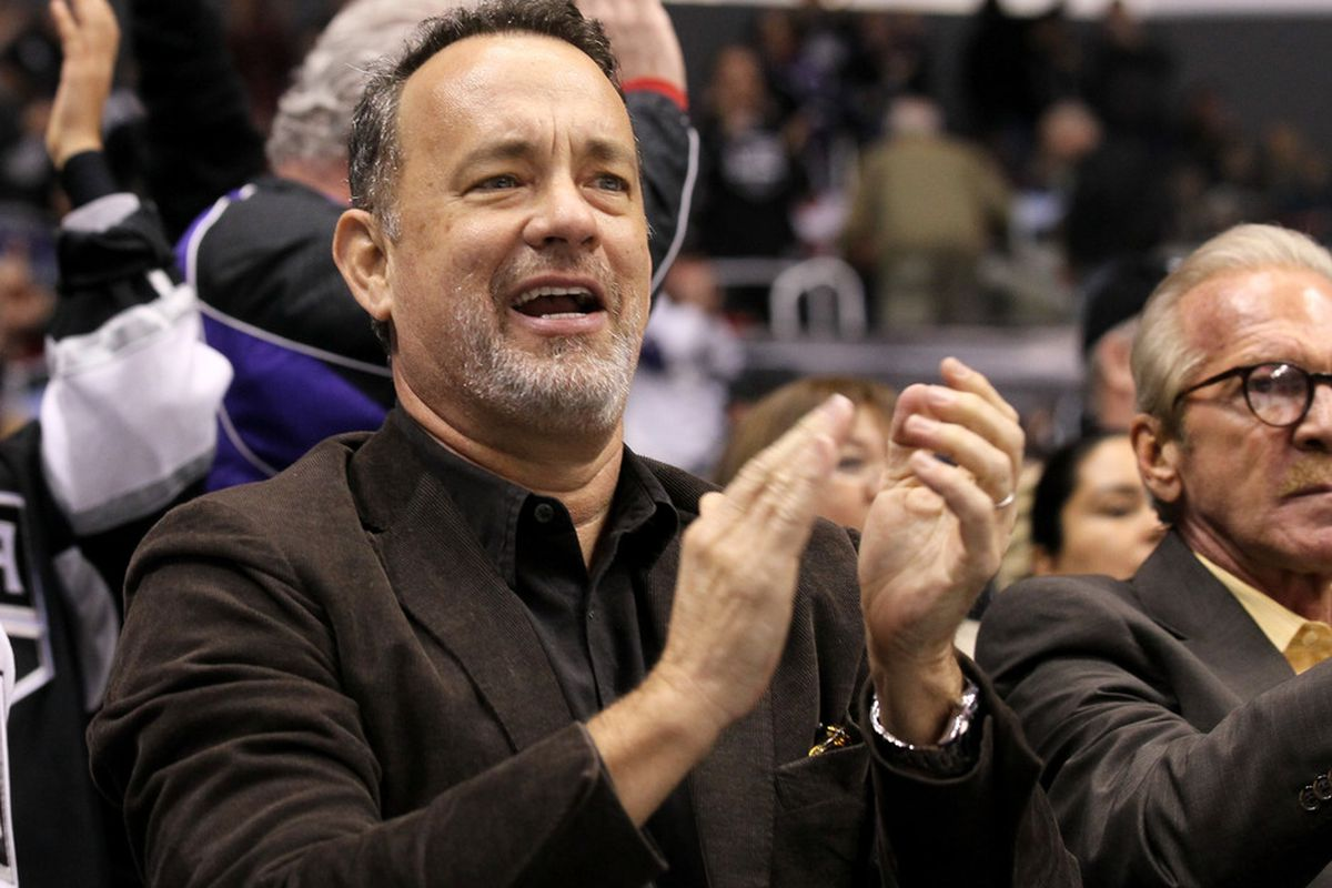 LOS ANGELES, CA - MARCH 13:  Actor Tom Hanks cheers after the Los Angeles Kingsfirst goal against the Detroit Red Wings at Staples Center on March 13, 2012 in Los Angeles, California.  (Photo by Stephen Dunn/Getty Images)