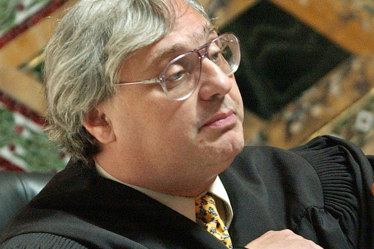 FILE - In this Sept. 22, 2003, file photo, Judge Alex Kozinski, of the 9th U.S. Circuit Court of Appeals, gestures in San Francisco. Krazinski announced his immediate retirement Monday, Dec. 18, 2017, days after women alleged he subjected them to inapprop