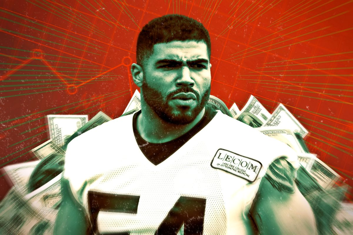 Mychal Kendricks with cash in the background