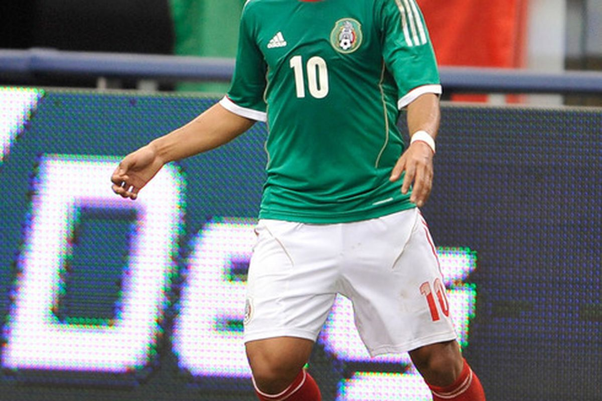 Jun 3, 2012; Arlington, TX, USA; Mexico forward Giovani dos Santos (10) looks to pass the ball during the second half against Brazil at Cowboys Stadium. Mexico shut out Brazil 2-0. Mandatory Credit: Jerome Miron-US PRESSWIRE