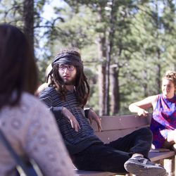 Gabi Sheeley, left, Eric Meeks and Meleeza Hall talk before the 9:30 a.m. nondenominational Christian church service in Bryce Canyon National Park, Sunday, June 18, 2017.