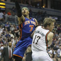 New York Knicks' Carmelo Anthony (7) puts up a shot against Milwaukee Bucks' Mike Dunleavy (17) during the first half of an NBA basketball game on Wednesday, April 11, 2012, in Milwaukee.