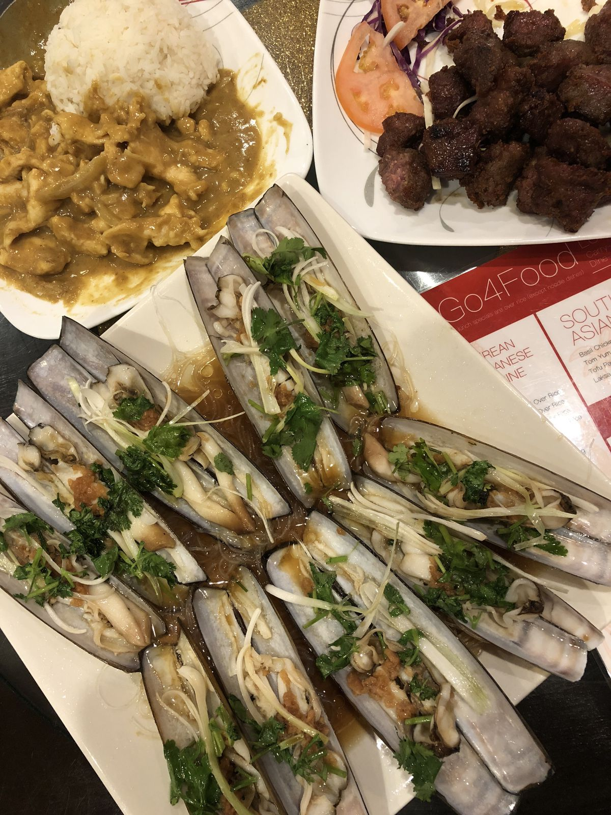 Razor Clams with vermicelli noodles, chicken curry, French fried beef at Go 4 Food in Chinatown.   Ji Suk Yi / Sun-Times