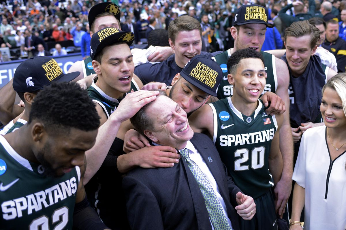 Tom Izzo celebrates with his teammates after reaching the Final Four