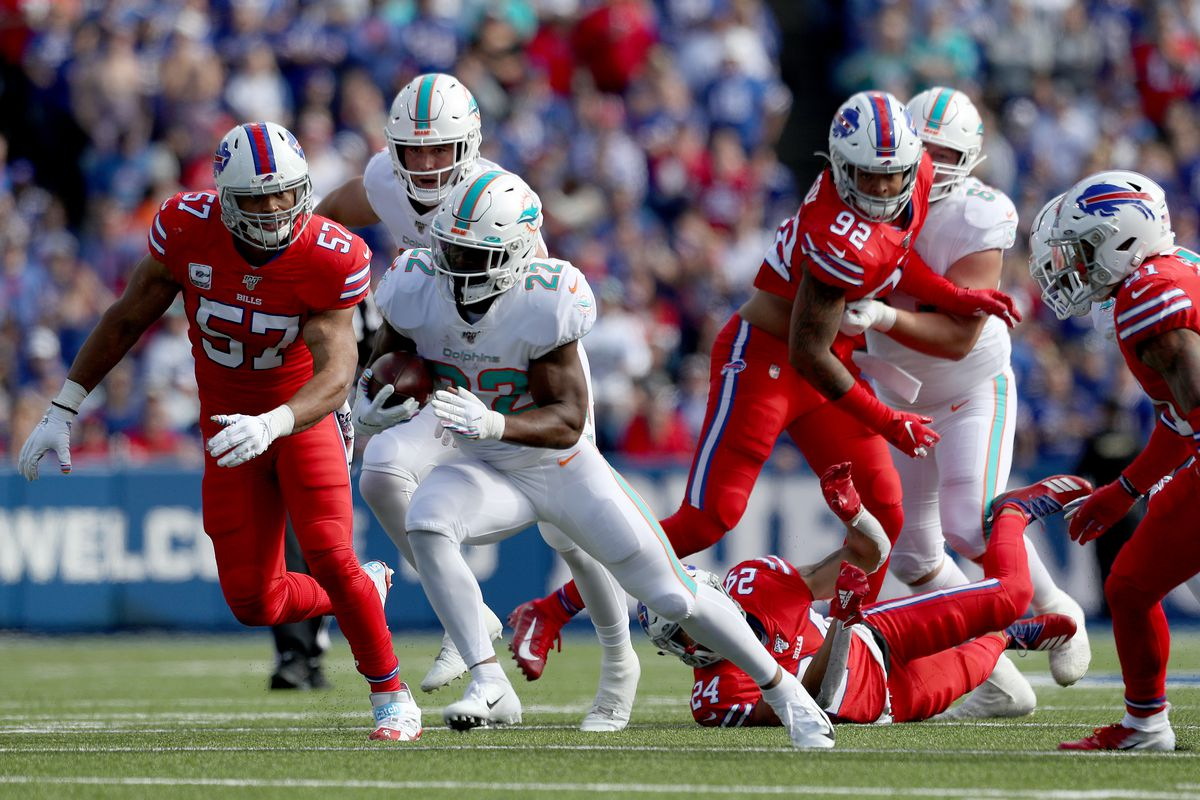 Mark Walton of the Miami Dolphins runs the ball during the first half of an NFL game against the Buffalo Bills at New Era Field on October 20, 2019 in Orchard Park, New York.