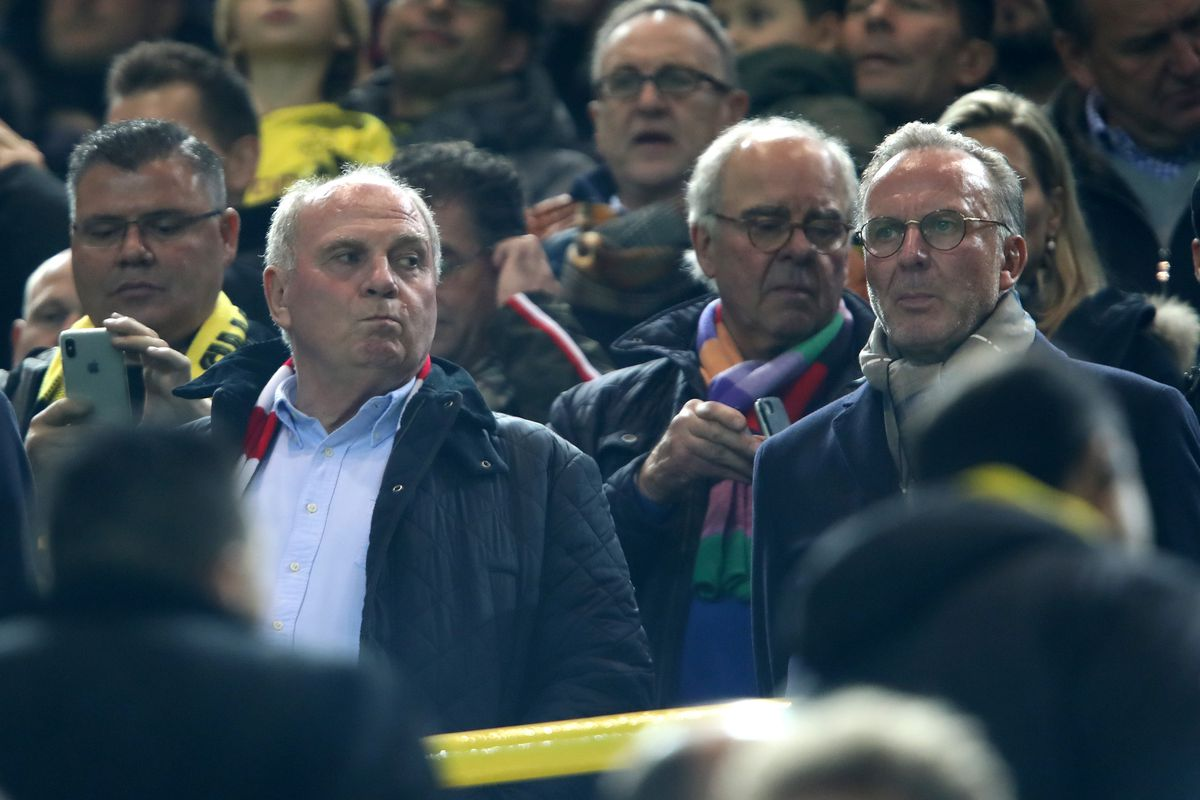 Borussia Dortmund v FC Bayern Muenchen - Bundesliga DORTMUND, GERMANY - NOVEMBER 10: Bayern Muenchen President, Uli Hoeness, and Bayern Muenchen CEO, Karl-Heinz Rummenigge, look on from the stands prior to the Bundesliga match between Borussia Dortmund and FC Bayern Muenchen at Signal Iduna Park on November 10, 2018 in Dortmund, Germany.