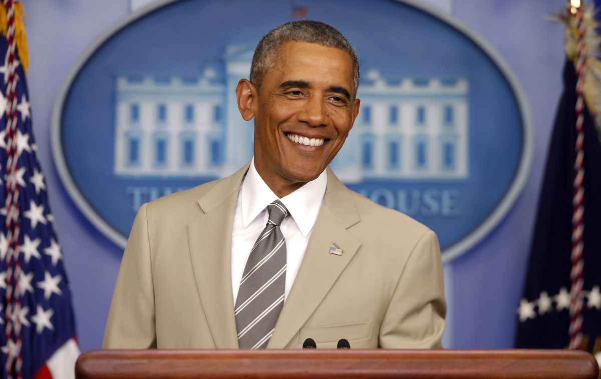 President Barack Obama smiles as he takes questions about the economy, Iraq, and Ukraine in August 2017. His tan suit caused an uproar on social media and among pundits. | Charles Dharapak/AP