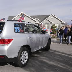 Vietnam veteran Warren Craig Eby waves from the passenger side window as he is greeted by friends, family and neighbors during a welcome home celebration in Saratoga Springs on Friday, Nov. 13, 2020. Eby was hospitalized for seven weeks with COVID-19