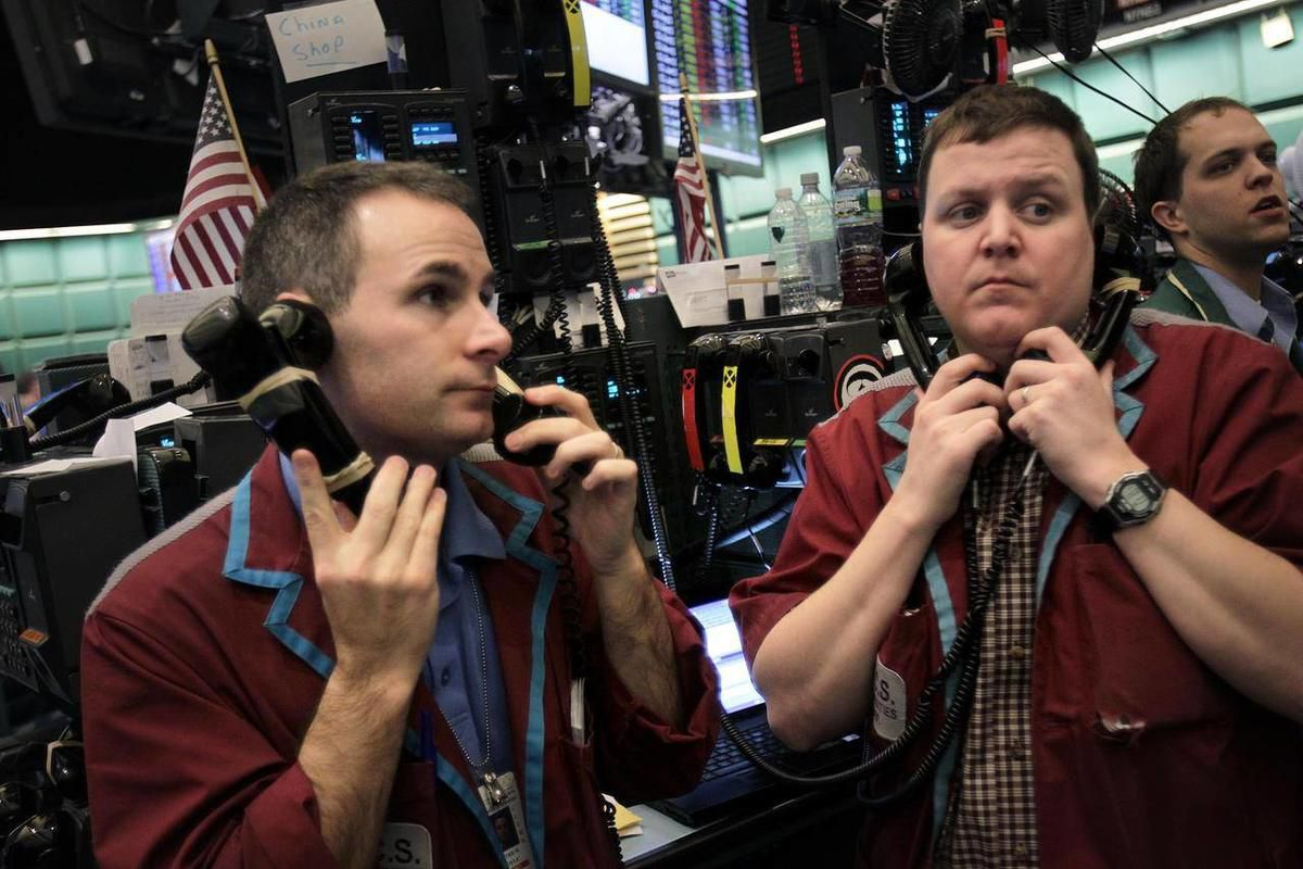 Traders work in the energy options pit at the New York Mercantile Exchange in New York, Wednesday, Feb. 29, 2012. Retail gasoline prices rose for the 22nd consecutive day to a national average of $3.73 per gallon. The Energy Department said gasoline suppl