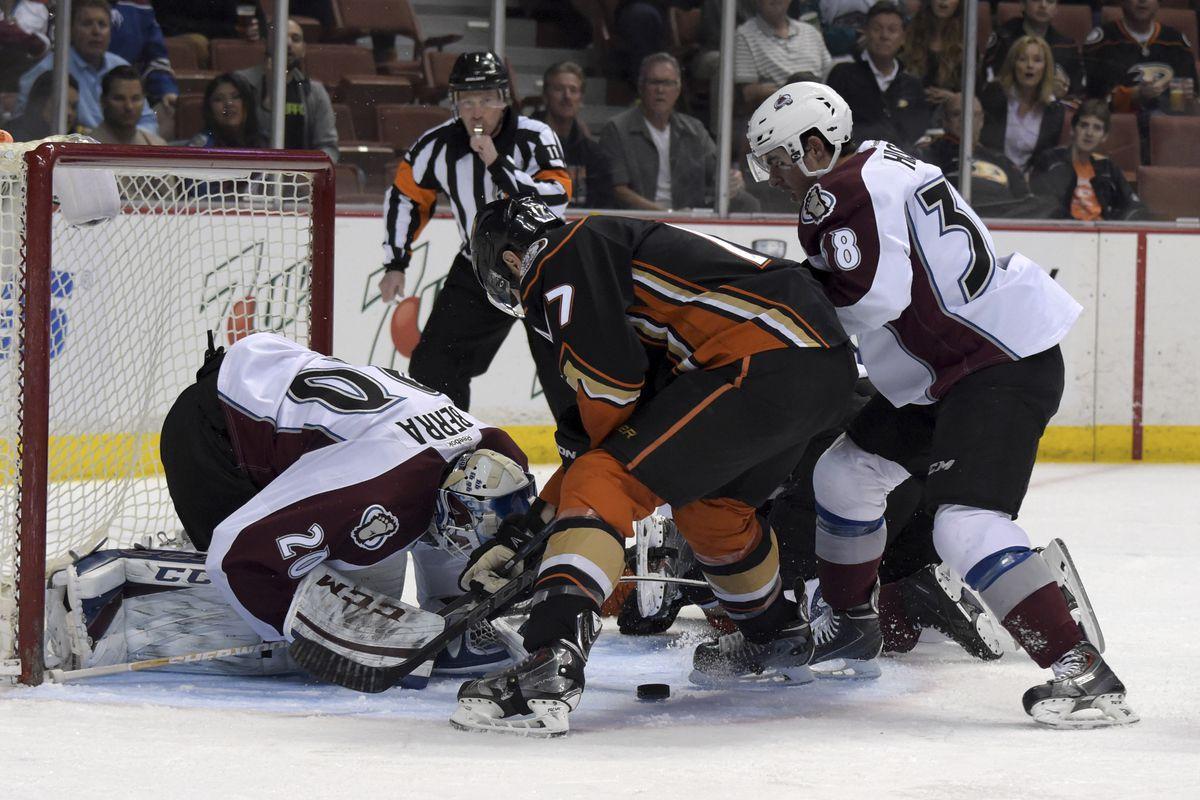 Ryan Kesler crashes for a rebound against Reto Berra and the Avalanche last season at Honda Center.