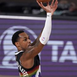 Denver Nuggets' Monte Morris (11) attempts a shot during the first half an NBA first round playoff basketball game against the Utah Jazz on Tuesday, Sept. 1, 2020, in Lake Buena Vista, Fla.