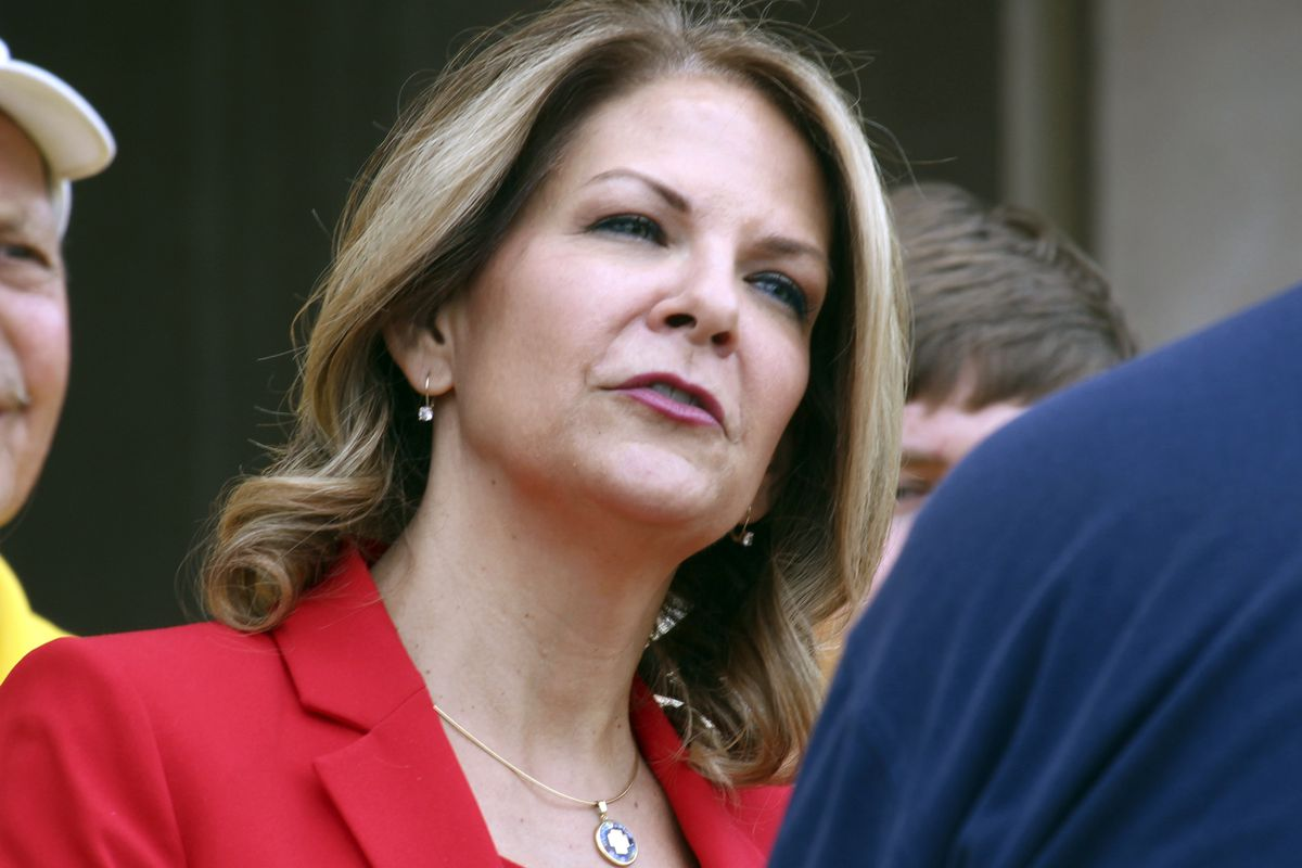 FILE - In this May 2, 2018 file photo, Arizona Republican U.S. Senate candidate Kelli Ward speaks to the media as she prepares to file her nominating petitions at the state Capitol in Phoenix. Ward, running for her party's nomination for an open Senate se