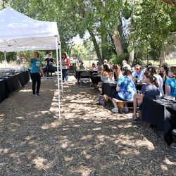 Krystal Rogers-Nelson, Real Food Rising program coordinator, speaks as guests eat lunch at the Real Food Rising farm in Salt Lake City on Wednesday, July 13, 2016.