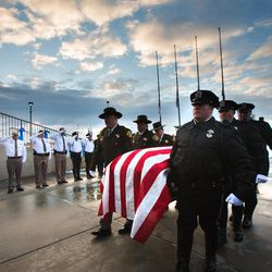 Unified police officer Doug Barney's casket is carried into the Maverik Center in West Valley City on Monday, Jan. 25, 2016, prior to his funeral.