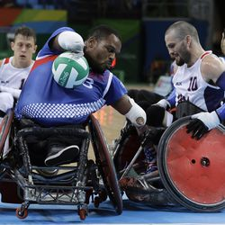 France's Cedric Nankin, left, fights for the ball with United States' Josh Wheeler during a mixed wheelchair rugby group B game at the Paralympic Games in Rio de Janeiro, Brazil, Wednesday, Sept. 14, 2016.