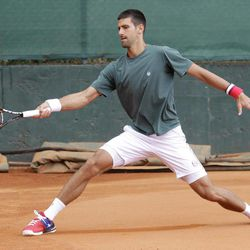 Novak Djokovic of Serbia returns the ball during a training session of the Monte Carlo Tennis Masters tournament in Monaco, Sunday, April 15, 2012.