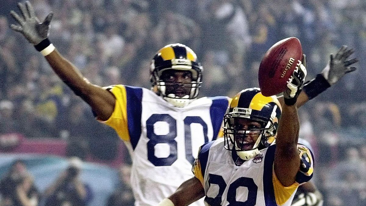 St. Louis Rams WR Torry Holt and WR Isaac Bruce celebrate Holt's touchdown catch during the second half of Super Bowl XXXIV, Jan. 30, 2000.