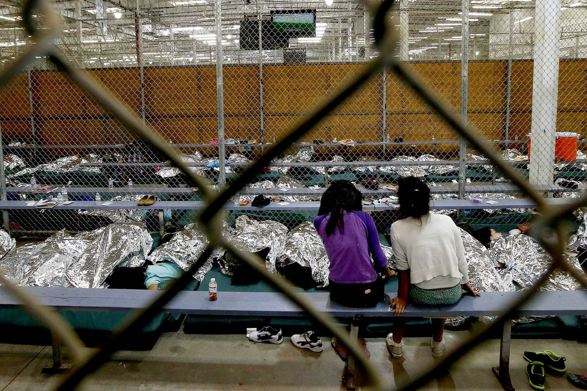 Girls sit in the US immigration detention facility in Nogales, Arizona