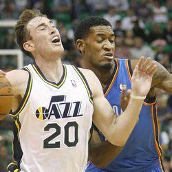 Utah's Gordon Hayward battles to get past Oklahoma's Perry Jones as the Utah Jazz and the Oklahoma City Thunder play Wednesday, Oct. 30, 2013.