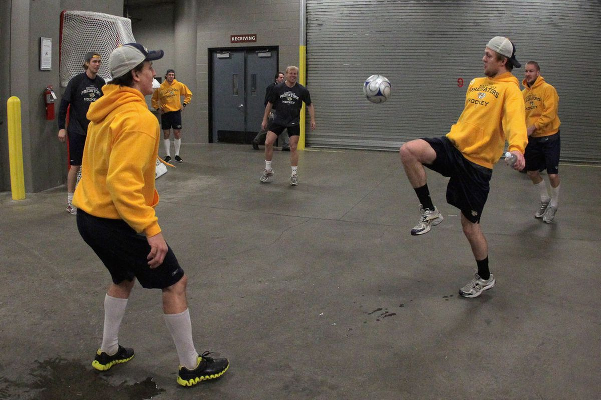 DENVER, CO - JANUARY 10:  Members of the Nashville Predators warm up by playing soccer prior to facing the Colorado Avalanche at the Pepsi Center on January 10, 2012 in Denver, Colorado.  (Photo by Doug Pensinger/Getty Images)