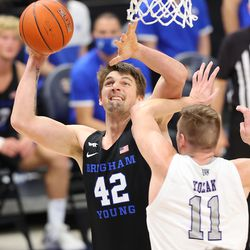 Brigham Young Cougars center Richard Harward (42) pushes up a shot over Weber State Wildcats forward Michal Kozak (11) as BYU and Weber State play an NCAA basketball game at Vivint Smart Home Arena in Salt Lake City on Wednesday, Dec. 23, 2020. BYU won 87-79.