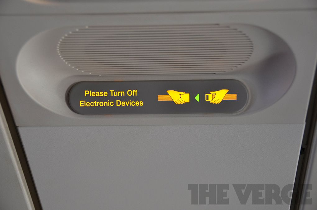 Please turn off electronic devices airplane stock (1020)
